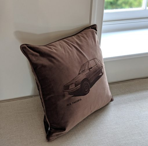 Side angle of 'Your Motor' cushion in the truffle colour, depicting a Peugeot