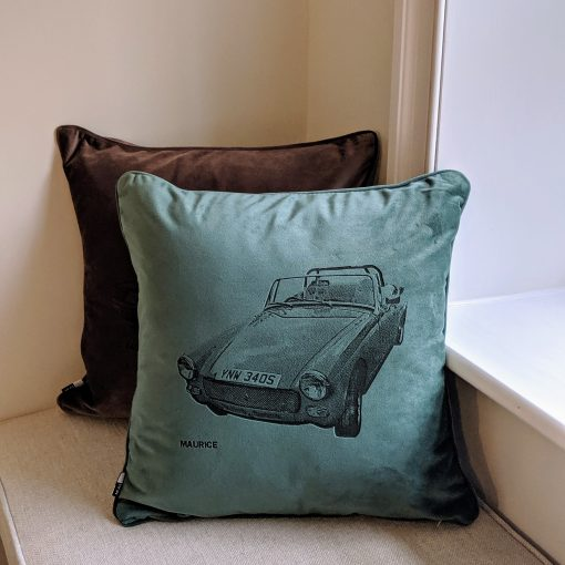 'Your Motor' velvet cushion in eucalyptus colour, depicting an MG