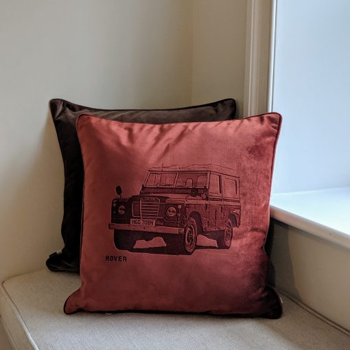 'Your Motor' velvet cushion in paprika, depicting a Land Rover